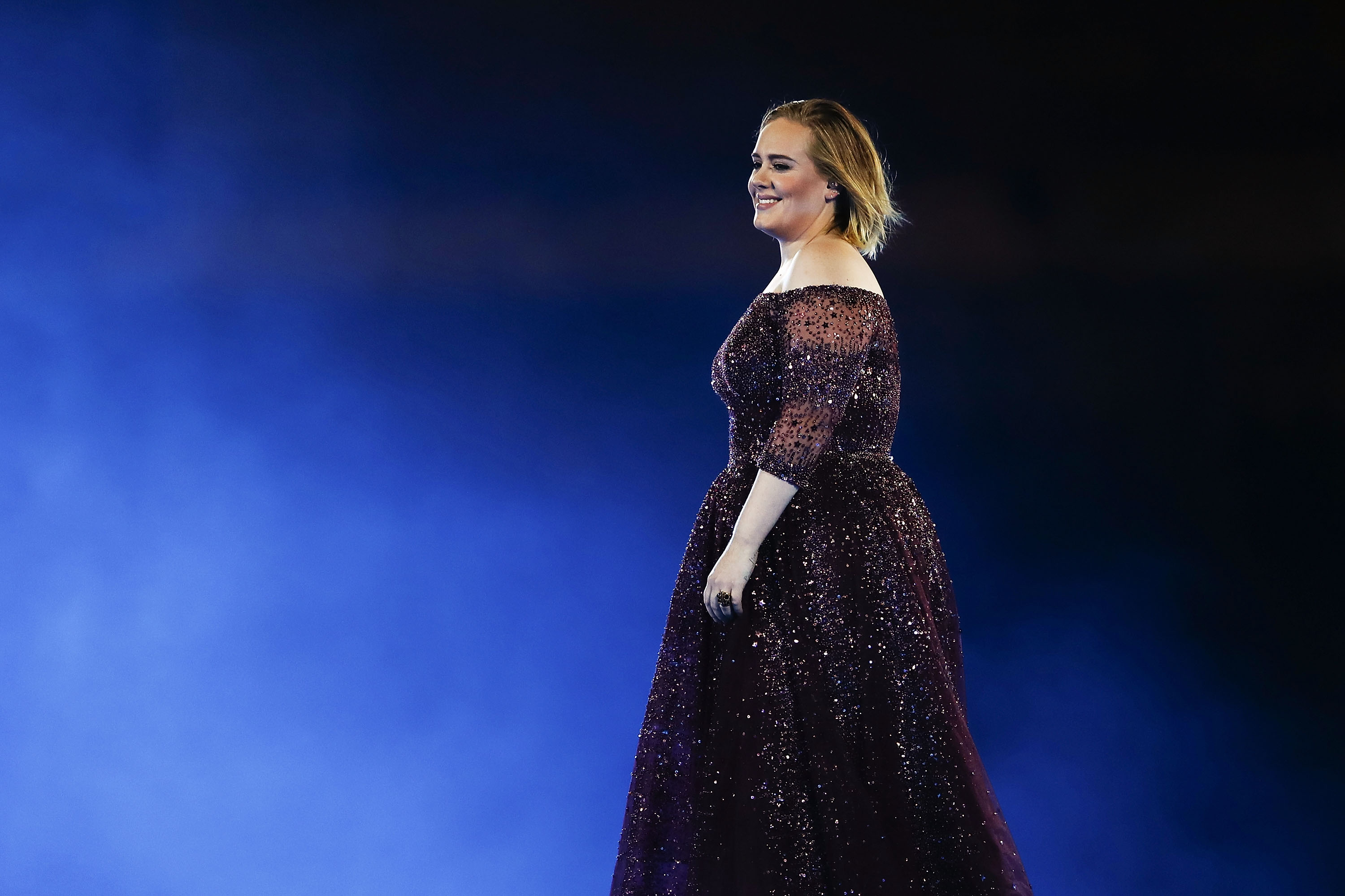 Adele live in concert in gown
